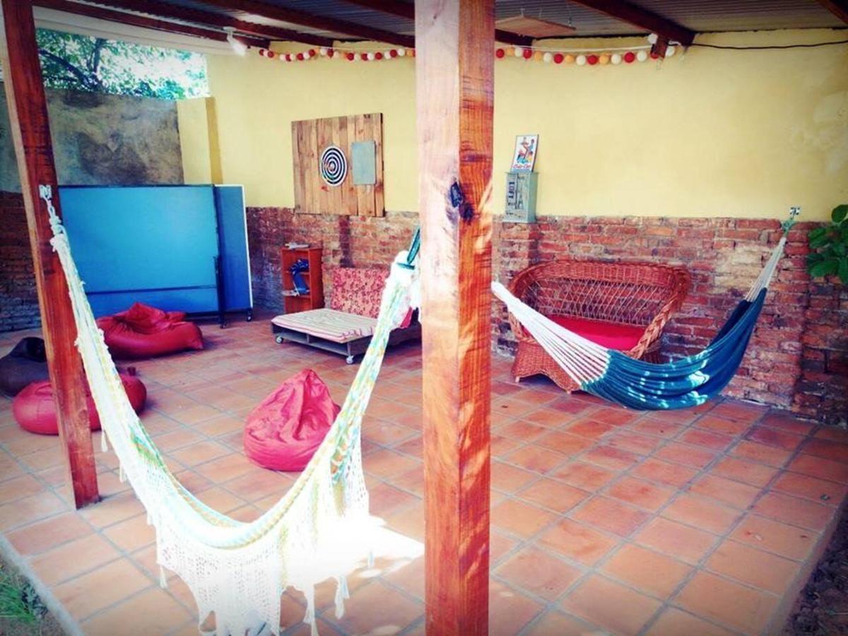 tennis table and hammocks in the game room of nomada hostel asuncion.jpg