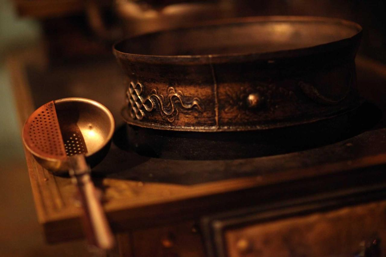 Tibetan tea pot and ladle.
