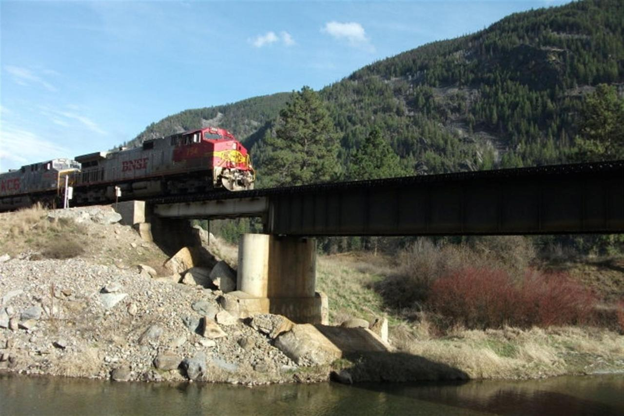 Train traveling over the Thompson River (by Jubilee Anderson).jpg