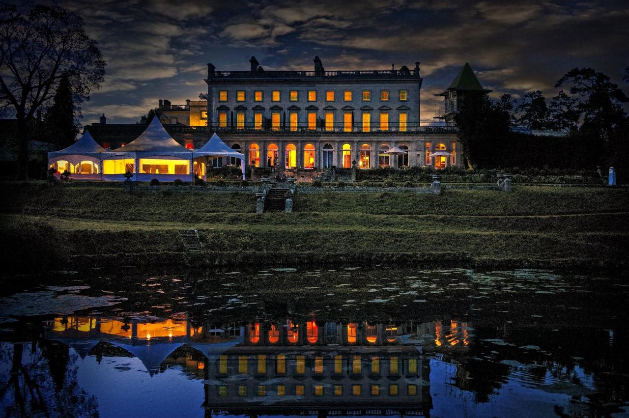 Cowley at night with marquee on the top lawn.jpg