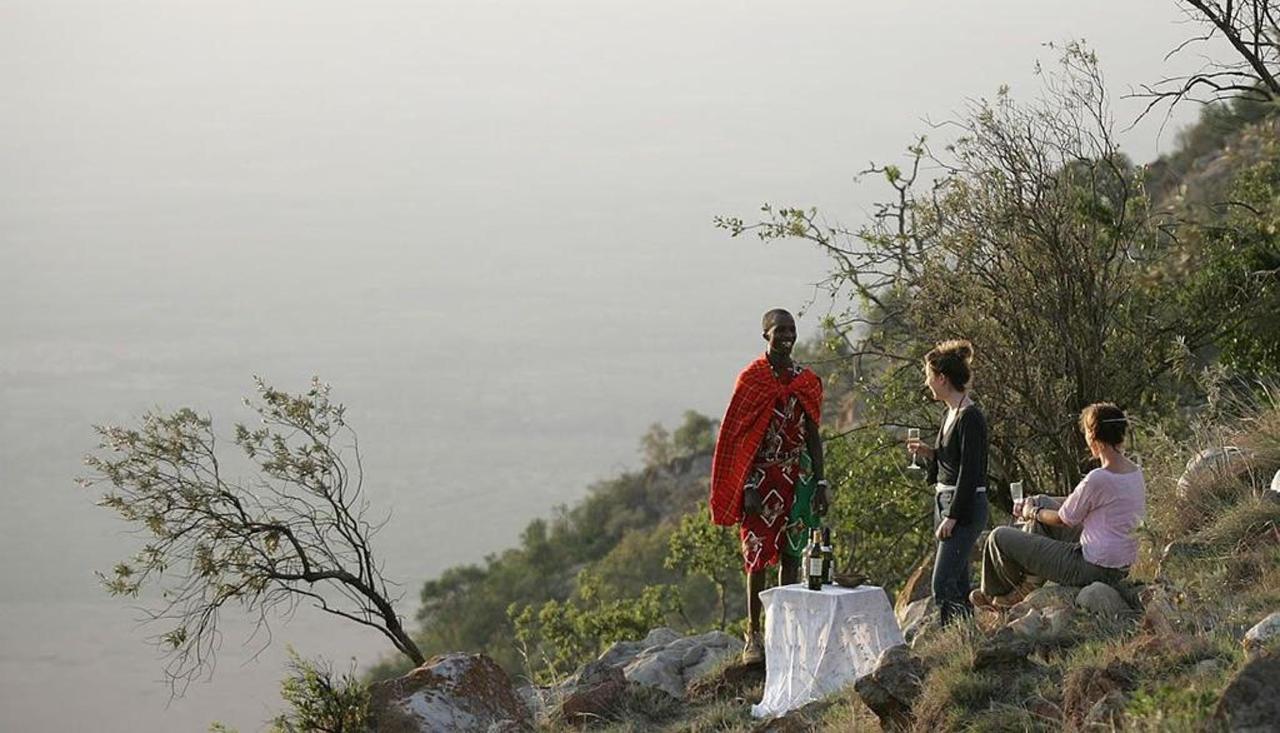 Sundowner overlooking the Masai Mara plains.jpg