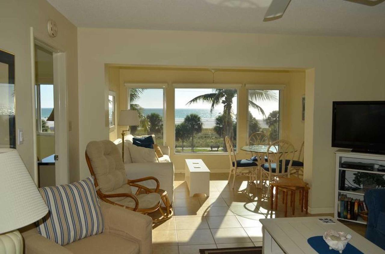 sr-condo-300-living-room-and-lanai-view.jpeg.1920x0.jpeg