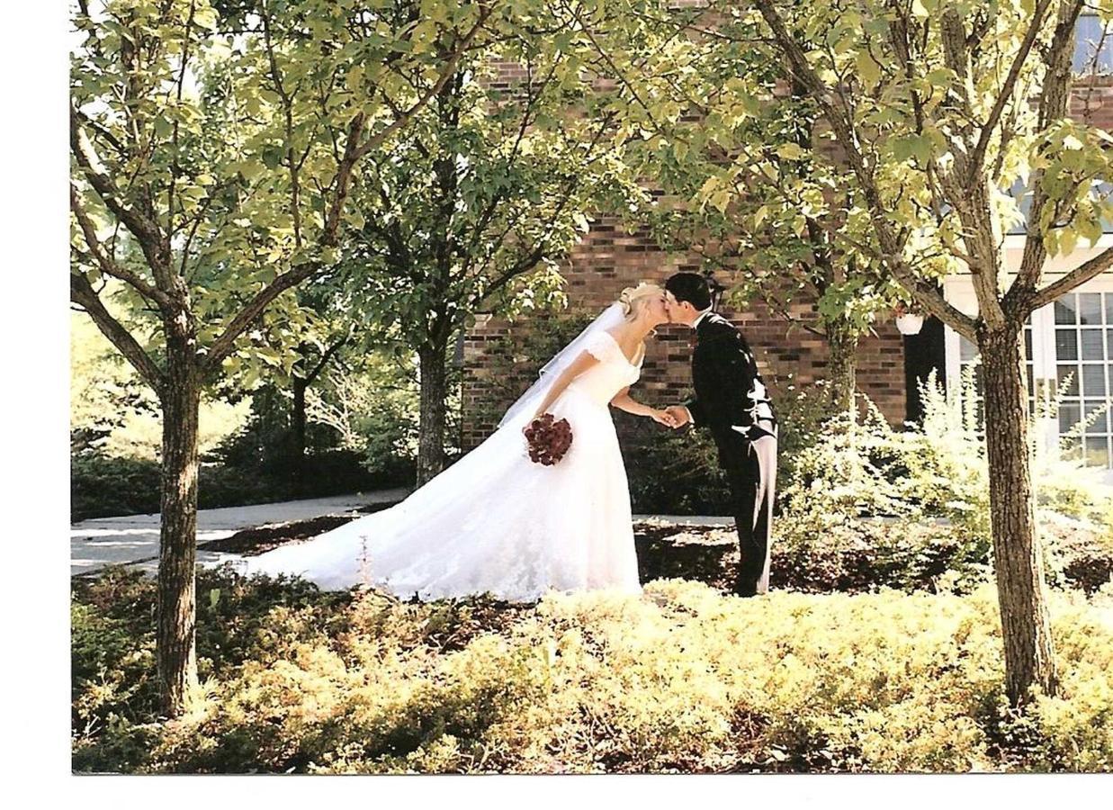 velvet-wedding-photo-under-trees-hotel-entrance.jpg.1920x0.jpg