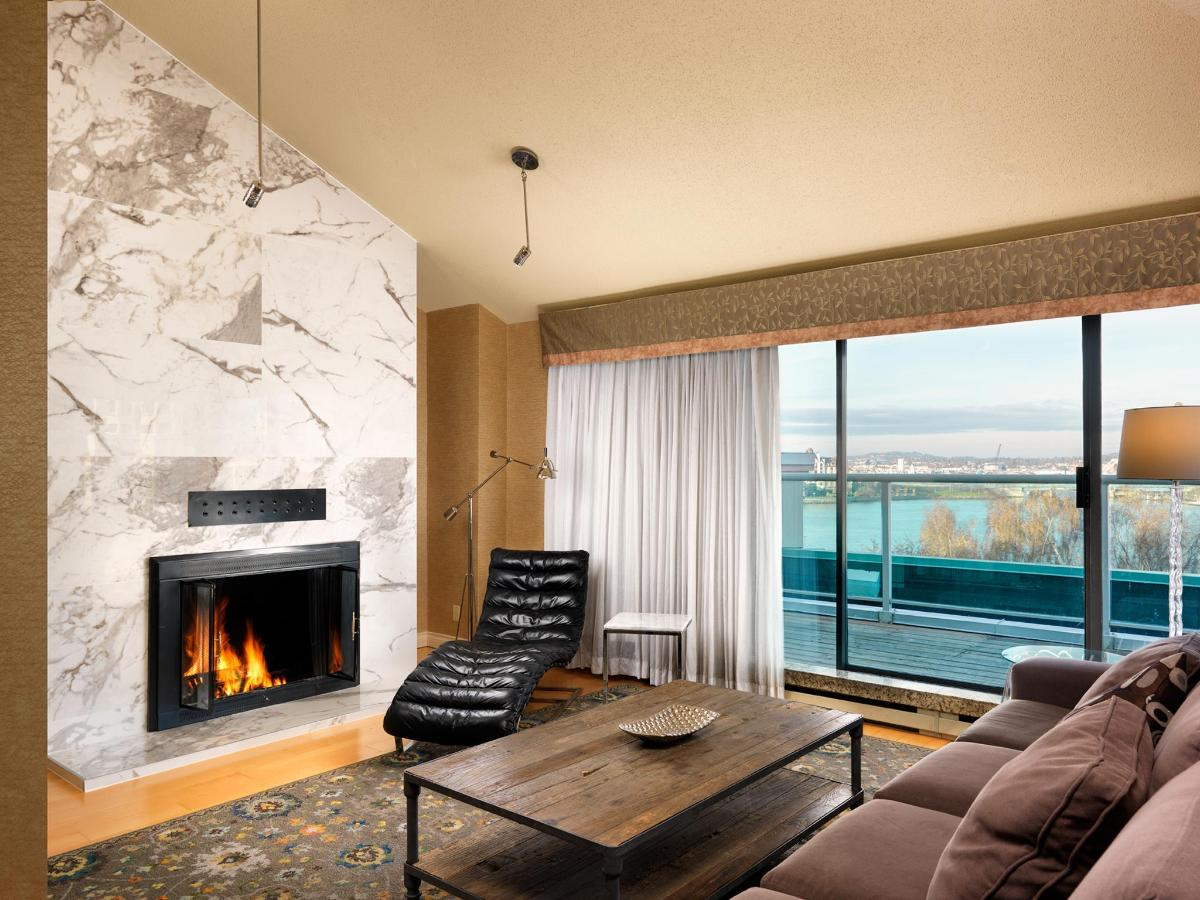 Living Room of the Two-Bedroom Penthouse Suite - Wood-Burning Fireplace and a beautiful view!.jpg