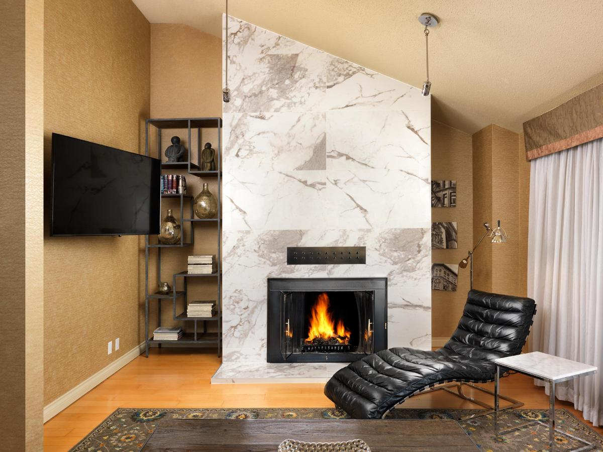Two-Bedroom Penthouse Living Room. Fireplace and 55