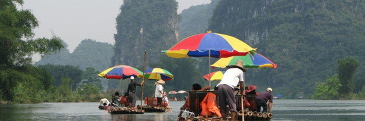 { Yulong River Bamboo Rafting }