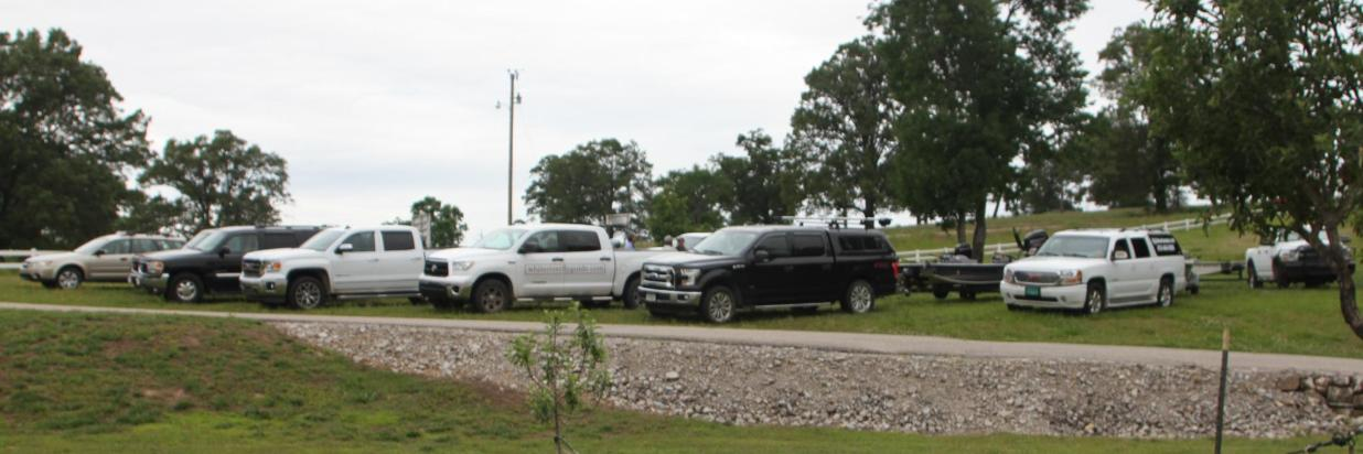 Guides llined up in parking area.JPG