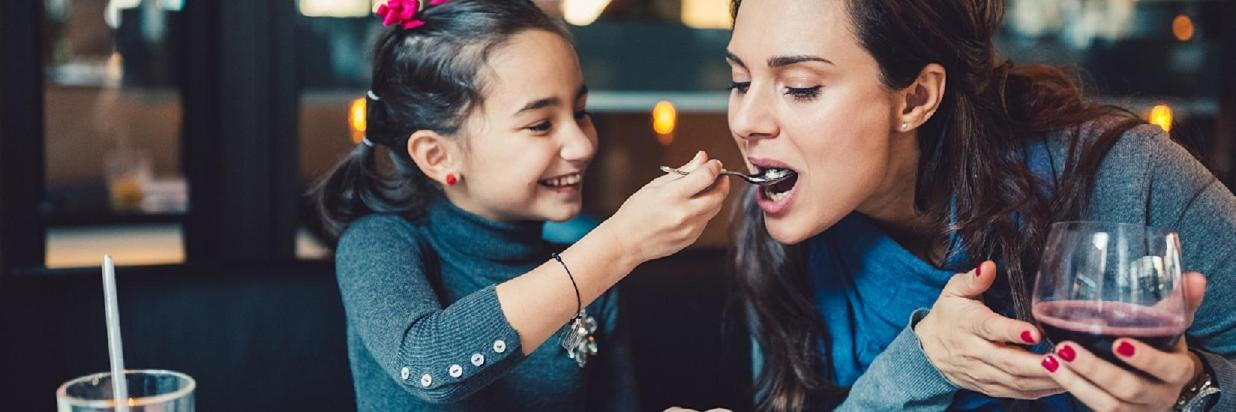 Mother and daughter eating- Website format.jpg