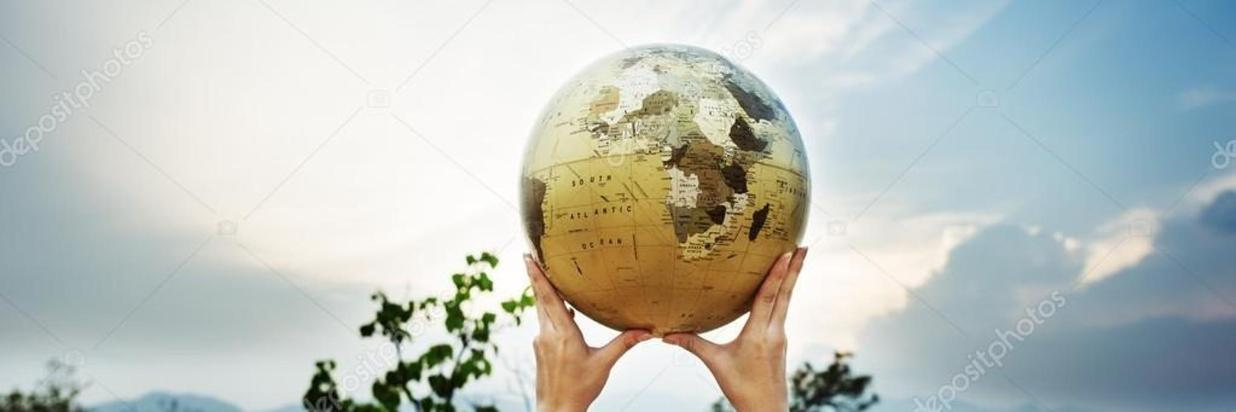 depositphotos_115692002-stock-photo-person-holding-globe.jpg