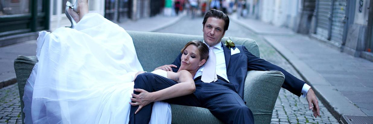 Hotel Slon Wedding Bride and Groom on the Street on the Couch.jpg