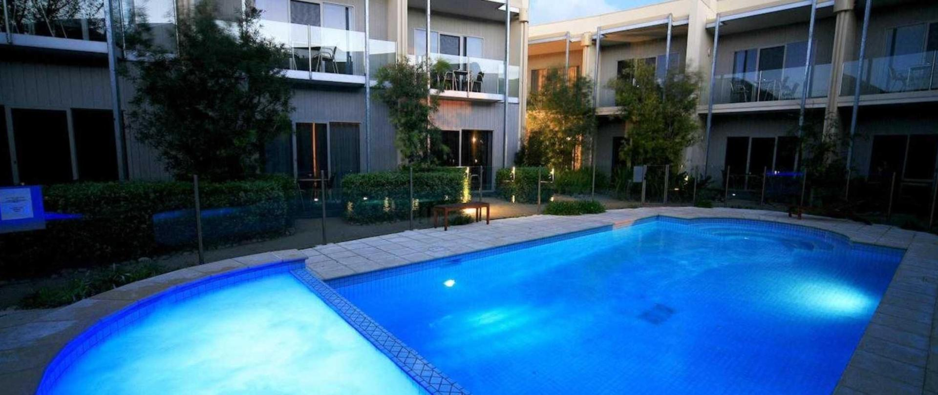 Poolside suites with swimming pool at night.jpg