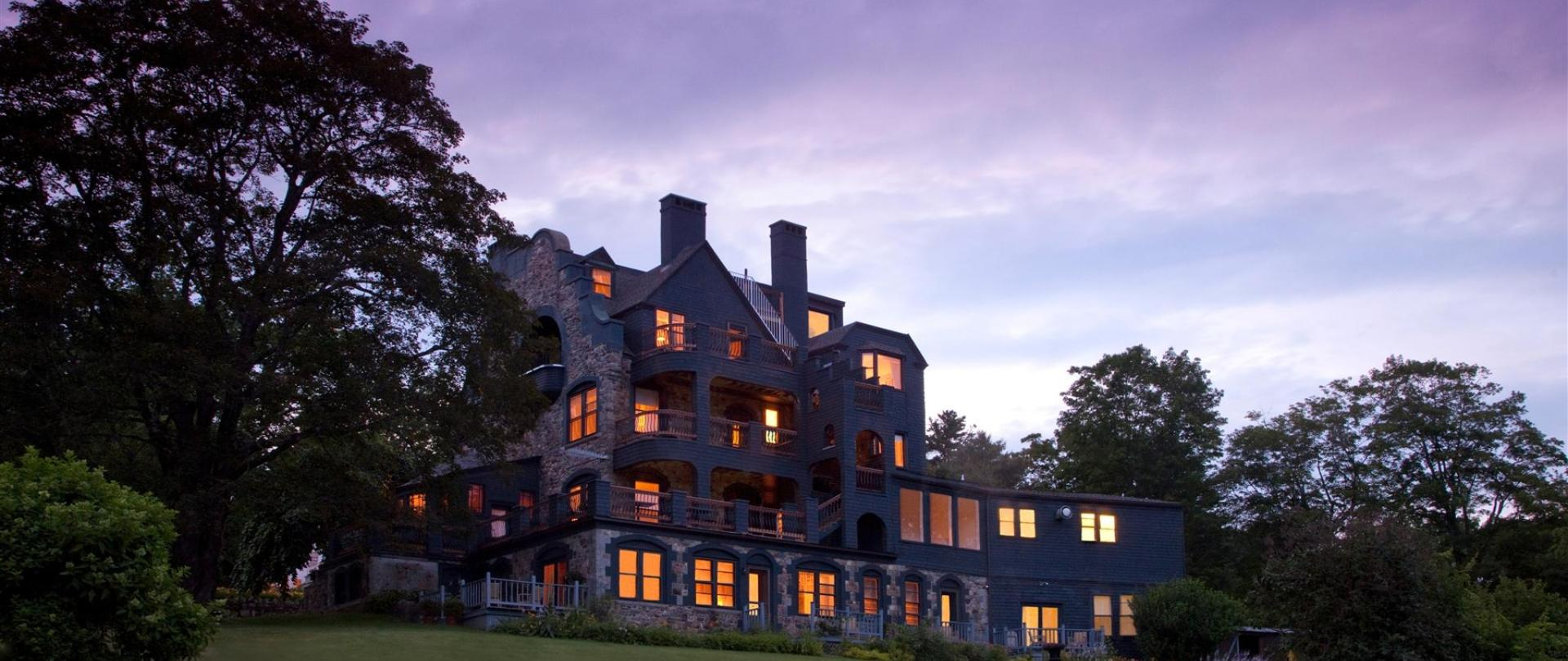 Norumbega Exterior from Back Lawn at Dusk