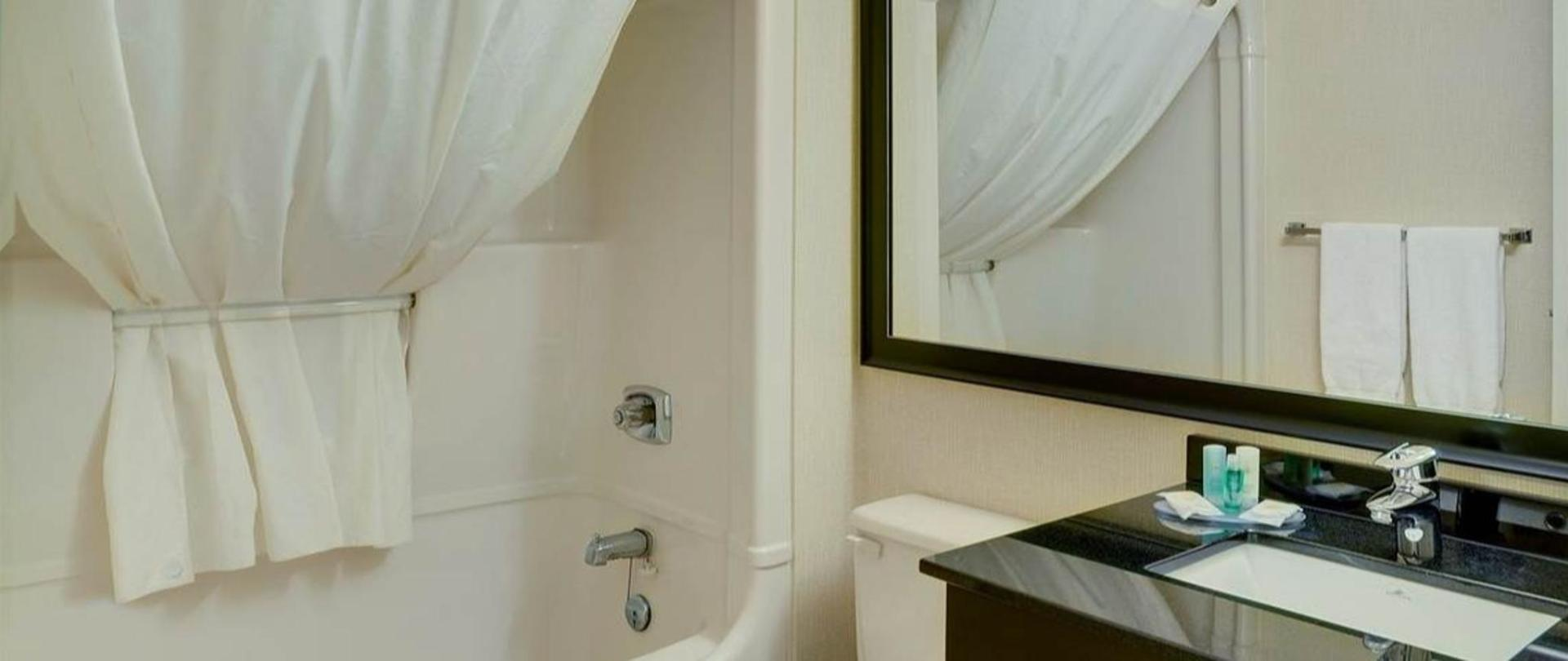 guest-bathroom-with-curved-shower-rod-new-tile-and-vanity.jpg.1140x481_default.jpg