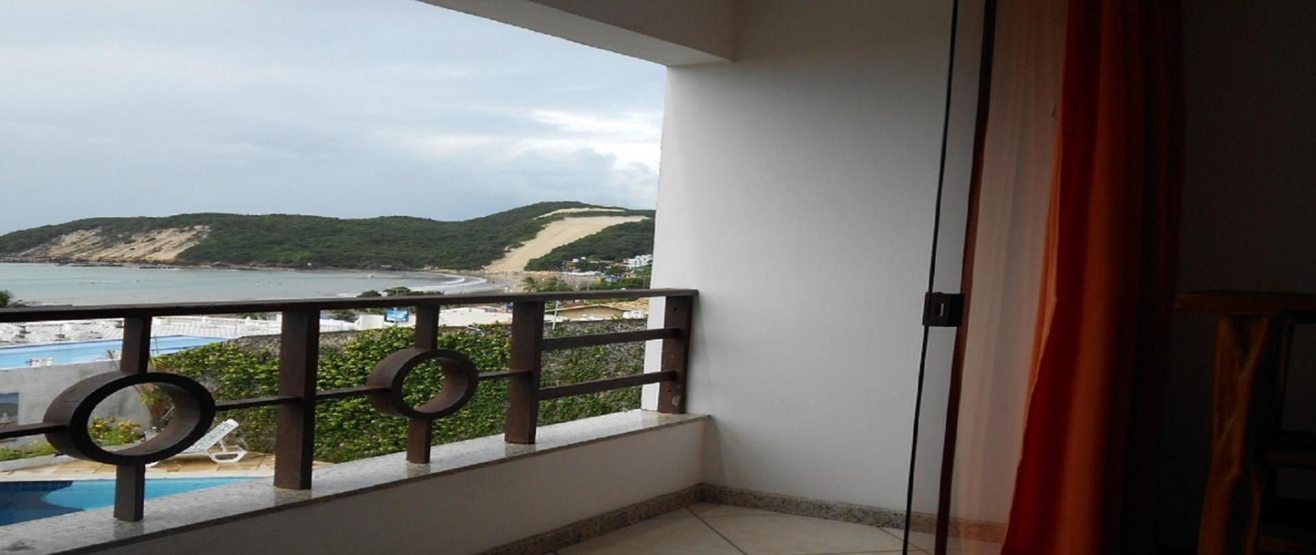 Flat com varanda vista mar e Morro do Careca