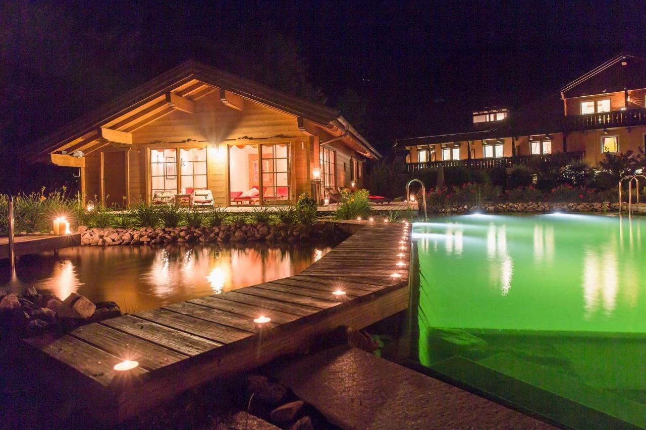 Pool at night with saunas.jpg