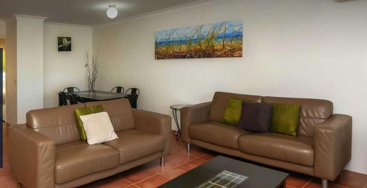 Living room sofas and dining table.jpg