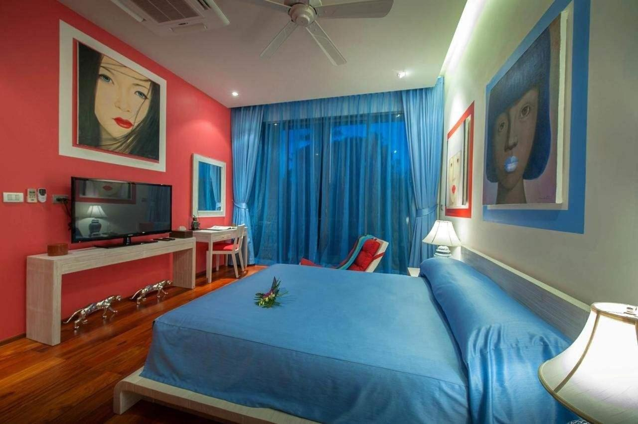Modern blue bedroom with double bed