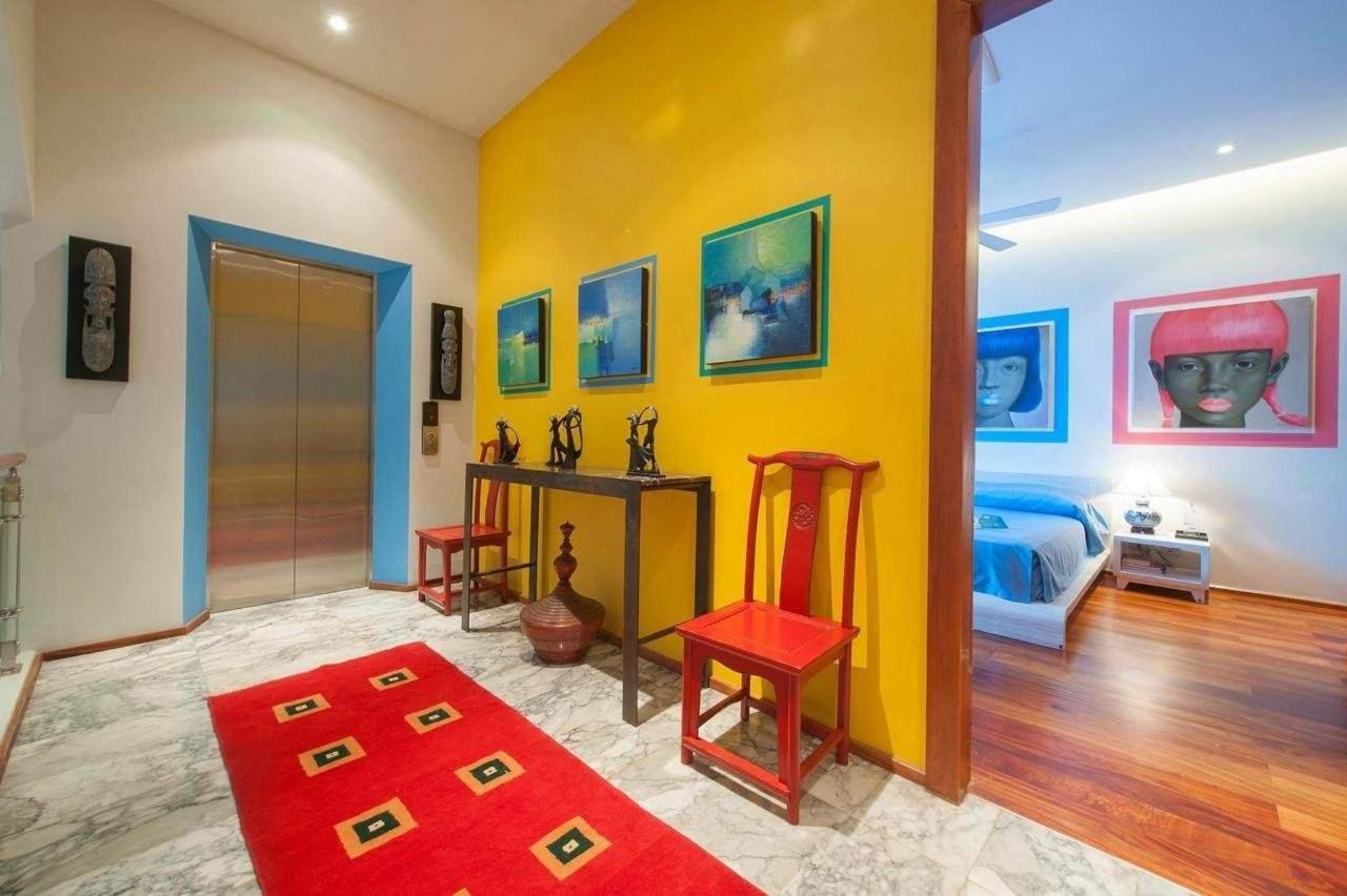 Interior design both modern and traditional Asian paintings and sculptures