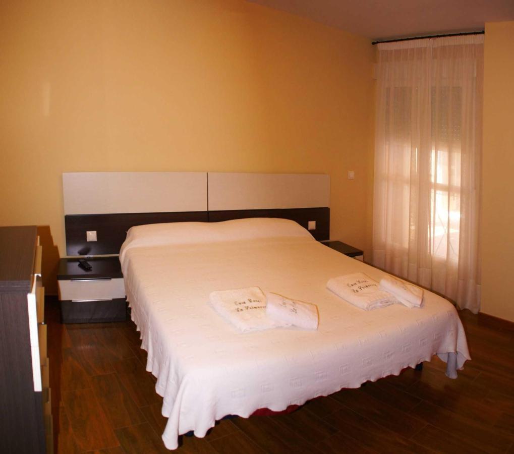 Dormitorio del Apartamento Cuatro Estaciones: acceso al balcón