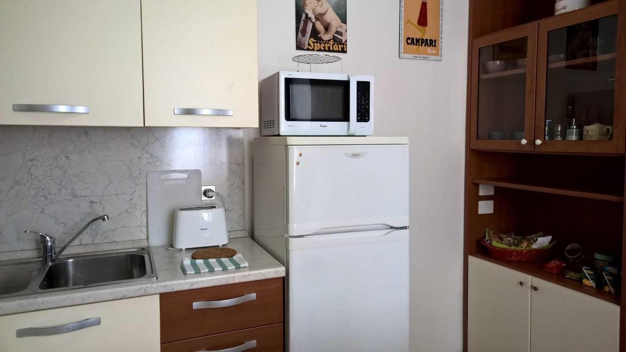toaster, refrigerator and TV