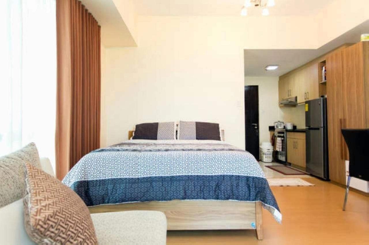 European Queen size bed in studio apartment