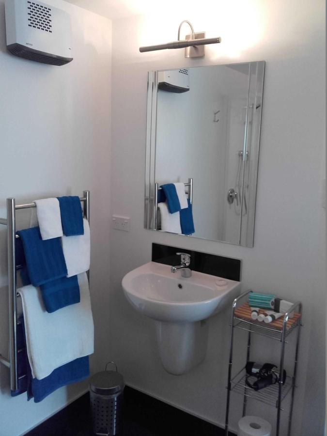 Ensuite with shower, toilet, washbasin, mirror, heater, toiletries. .jpg
