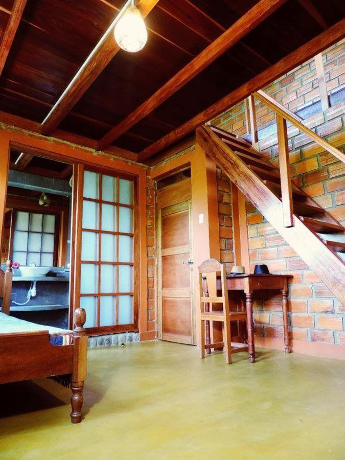 View of the stairway to the second floor of 1 of 4 separate apartments within the lodge..jpg