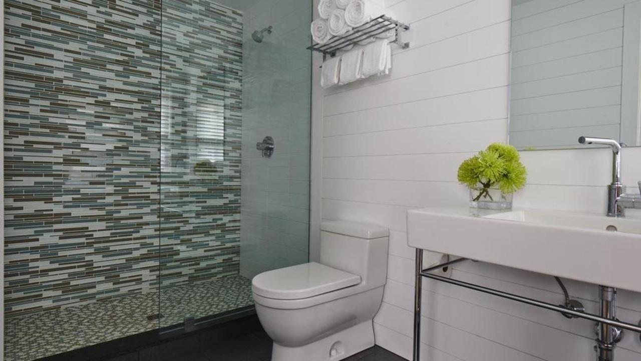 Spacious Bathroom with Large Shower offered in our Luxury King or Cozy Queen Guest Room