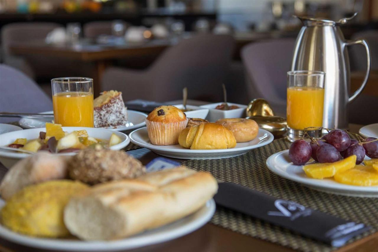 Flores Boutique Hotel & Spa delicious breakfast with Portuguese delicacies