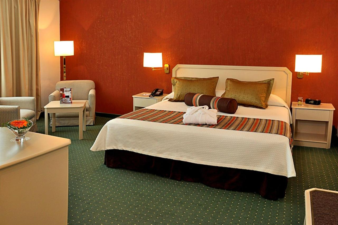 A Premium Executive room with a King-size bed
