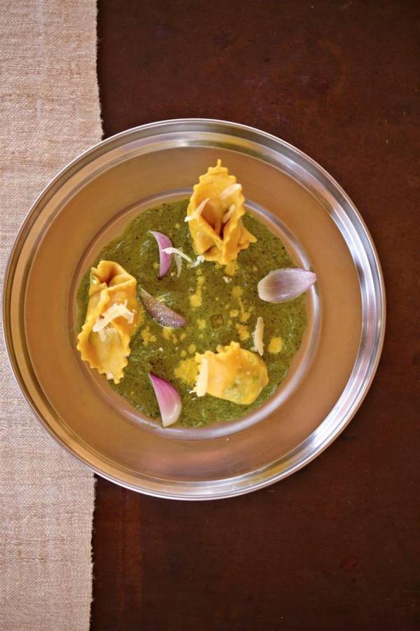 Spinach Ricotta ravioli peas cream and roasted petals of roasted onions.jpg