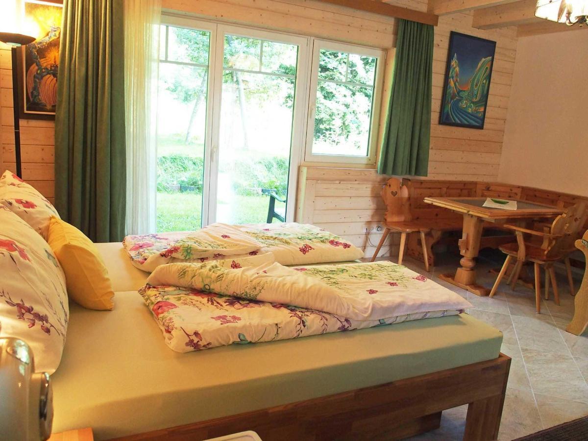 Gartenzimmer mit Sitzecke