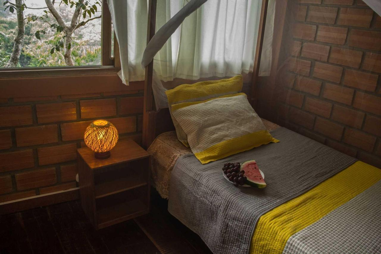 Single bed in second floor. Healthy breakfast with the best view of the Cerro Escalera reserve.JPG