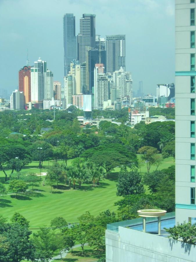 Makati skyline view from city facing apartments.jpg