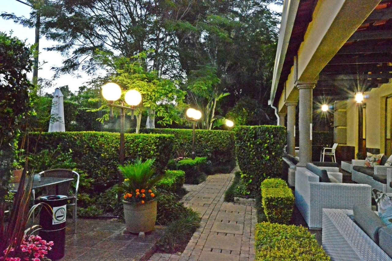 Garden and patio at night at Constantia Manor Guesthouse