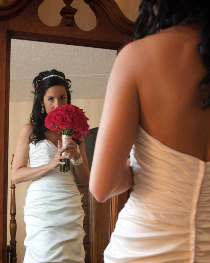 kelly-and-ryan-bride-stands-w-reflection-in-mirror.jpg.1920x0.jpg
