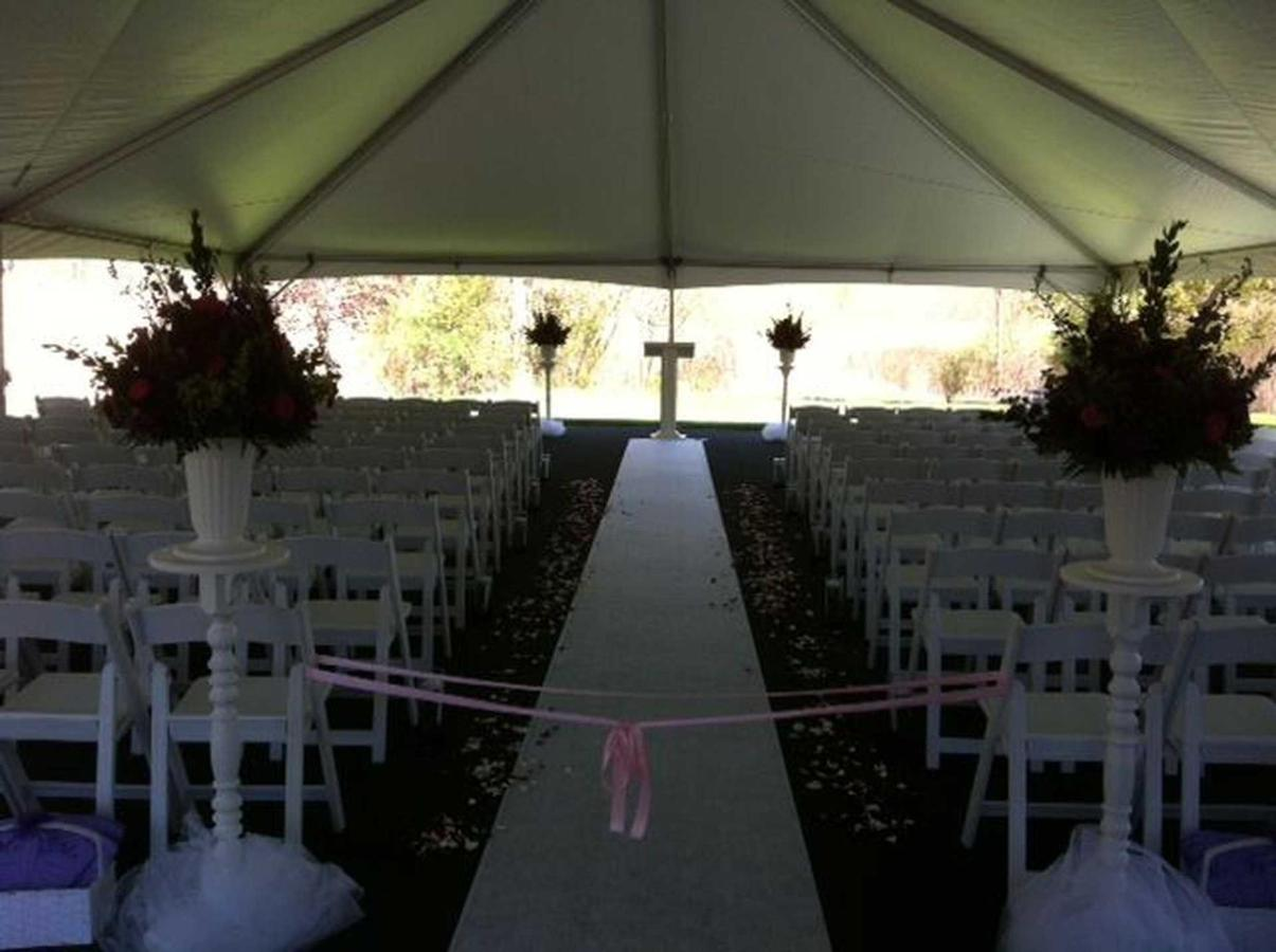 tent-ceremony-with-runner-pink-ribbon.JPG.1920x0.JPG