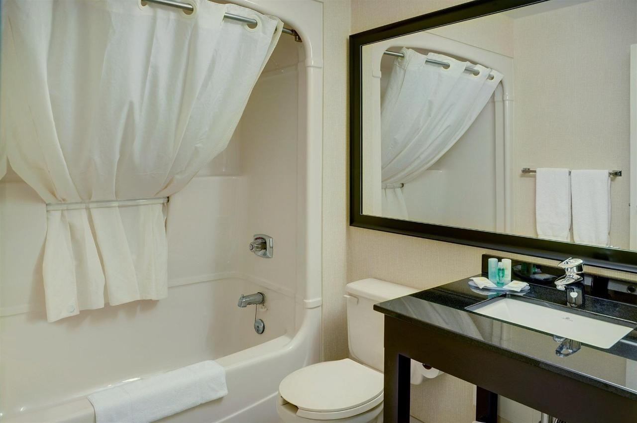 guest-bathroom-with-curved-shower-rod-new-tile-and-vanity-1.jpg