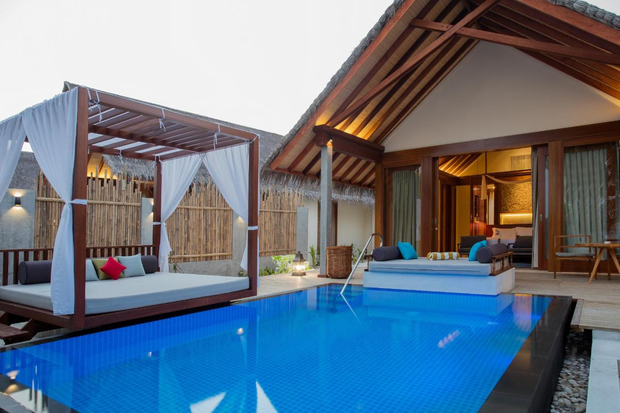 Beach Pool Villa - pool, day bed and bedroom view.jpg