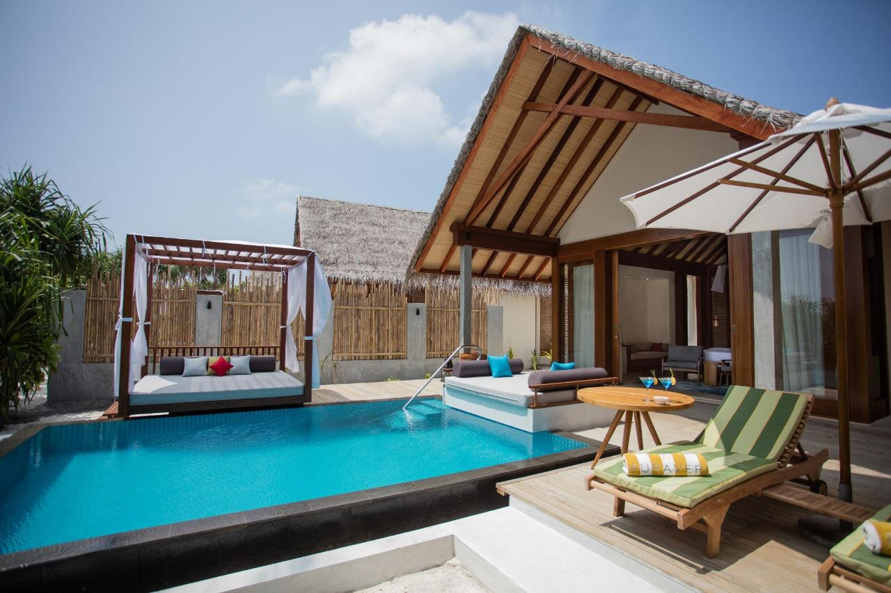 Beach Pool Villa - pool, day bed and deck side view.jpg