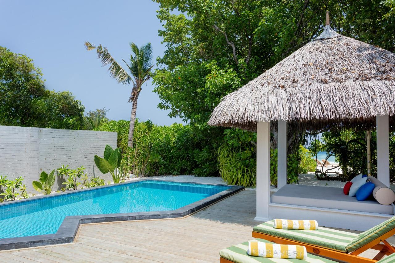 Dhoni Pool Villa - deck, pool and beach view.jpg