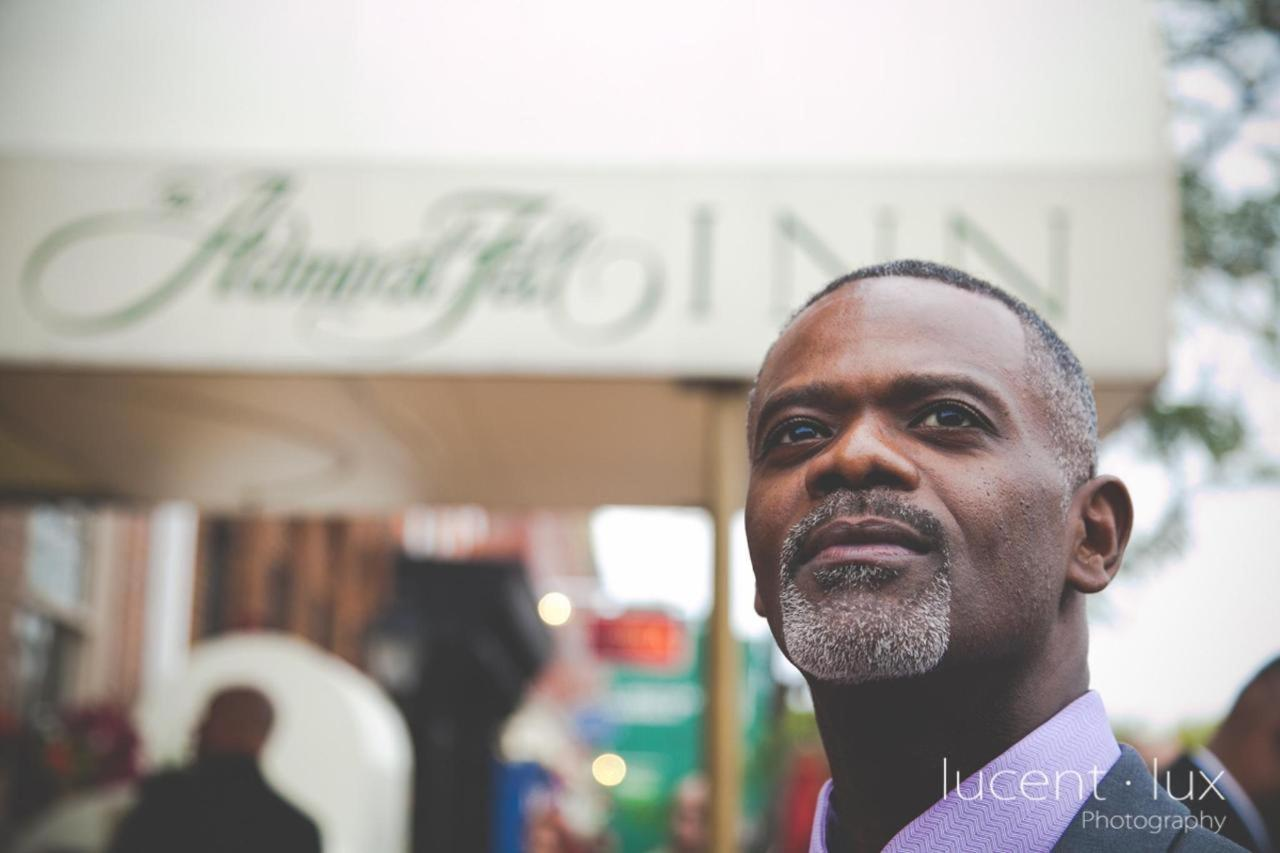 Admiral Fell Inn Groom Outside Hotel Shot by Lucent Lux Photography.jpg