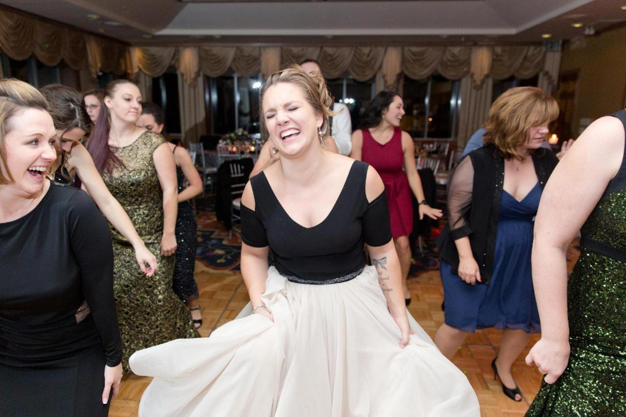Admiral Fell Inn Bridal Smiling and Dancing at Reception Shot by Amy and Jordan Photography.jpg