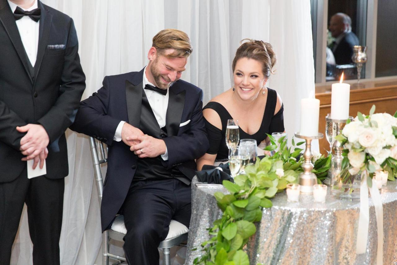 Admiral Fell Inn Bride and Groom Smiling at Sweetheart Table Shot by Amy and Jordan Photography.jpg