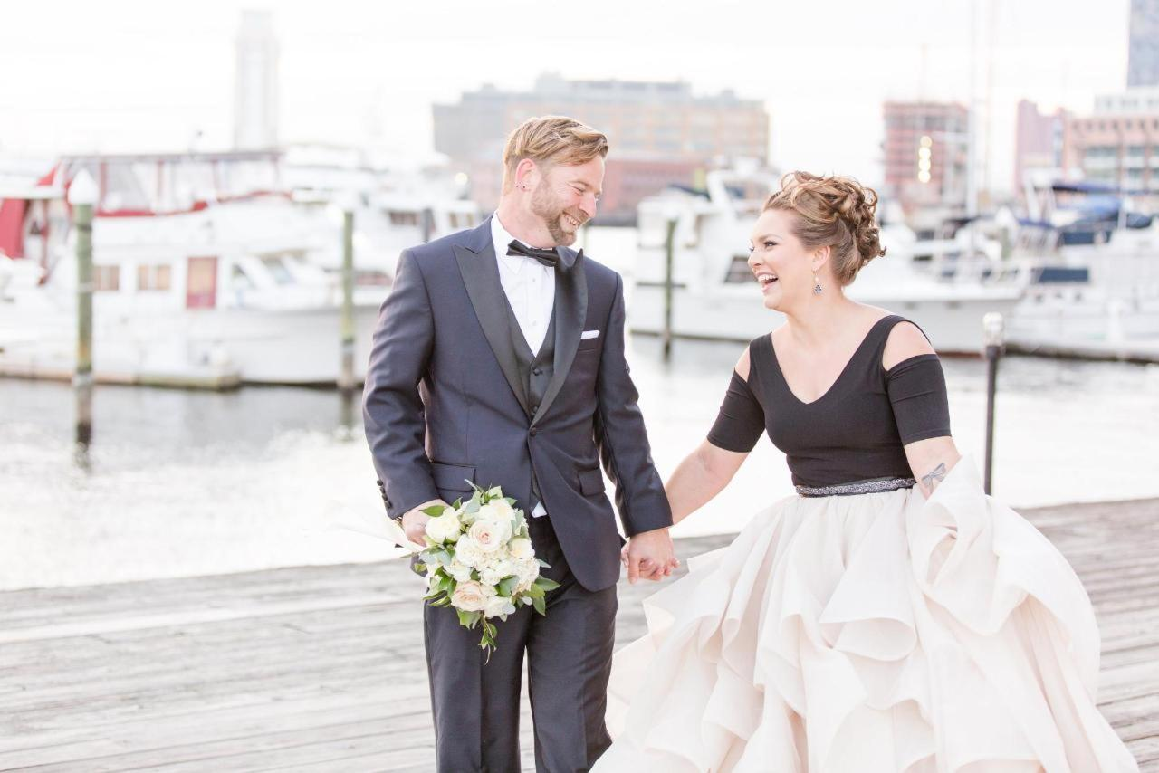 Admiral Fell Inn Bride and Groom Smiling on Henderson's Wharf Marina Shot by Amy and Jordan Photography.jpg