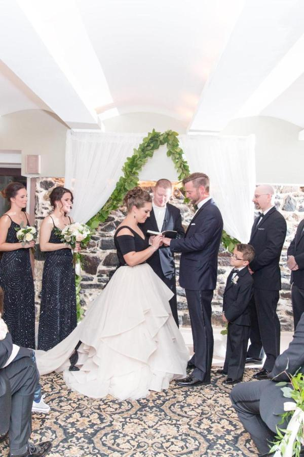 Admiral Fell Inn Horizontal Ceremony Stone Room Shot by Amy and Jordan Photography.jpg