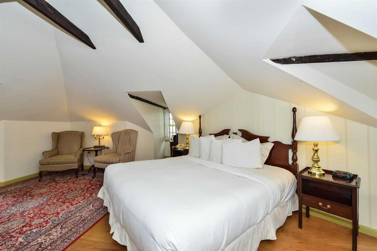 Admiral Fell Inn King Bed Catherdal Guest Room.jpg