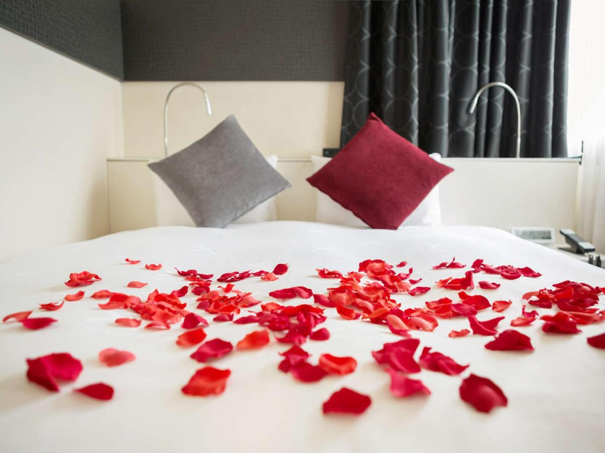 Bed Decoration with Scattered Petals.jpg