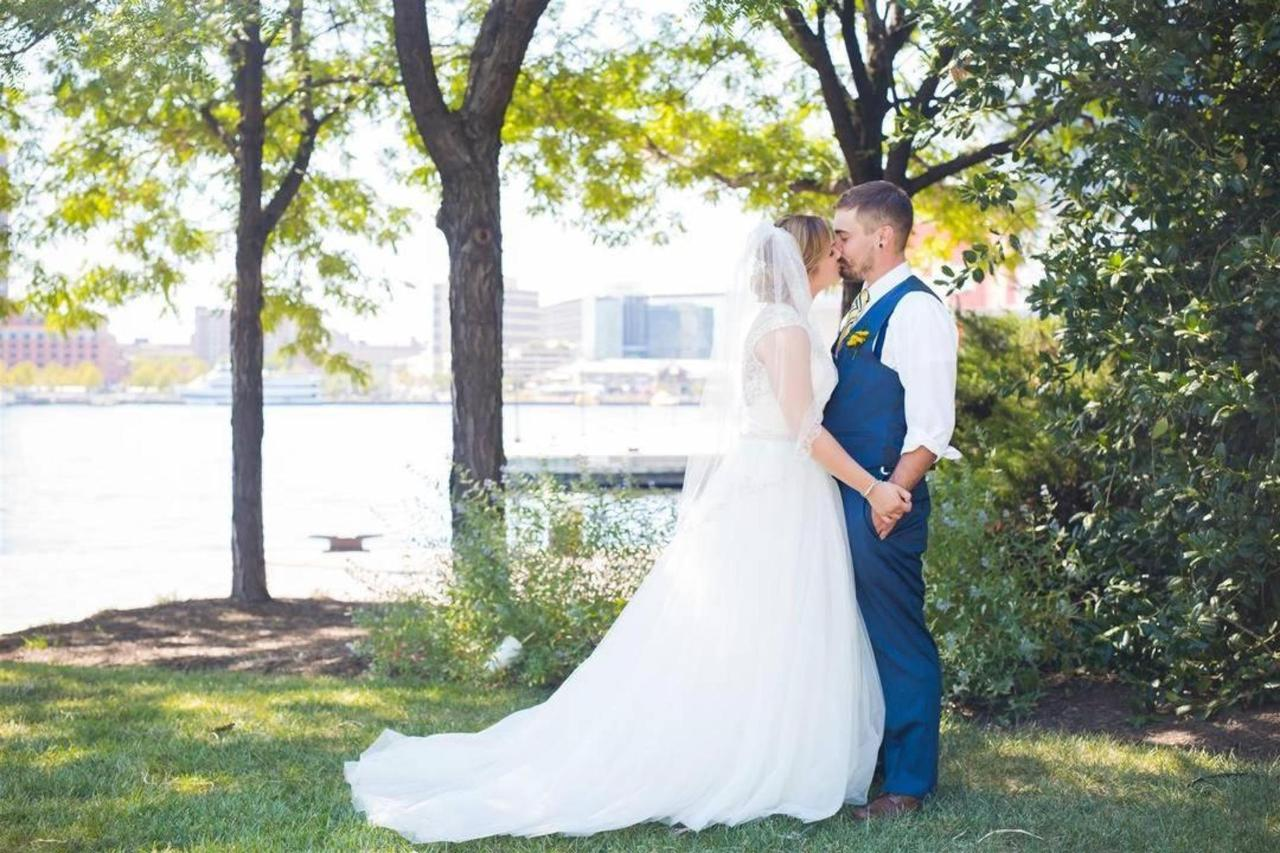 Pier 5 Hotel Bride and Groom Day Kiss Shot Captured by Photography by Brea.jpg