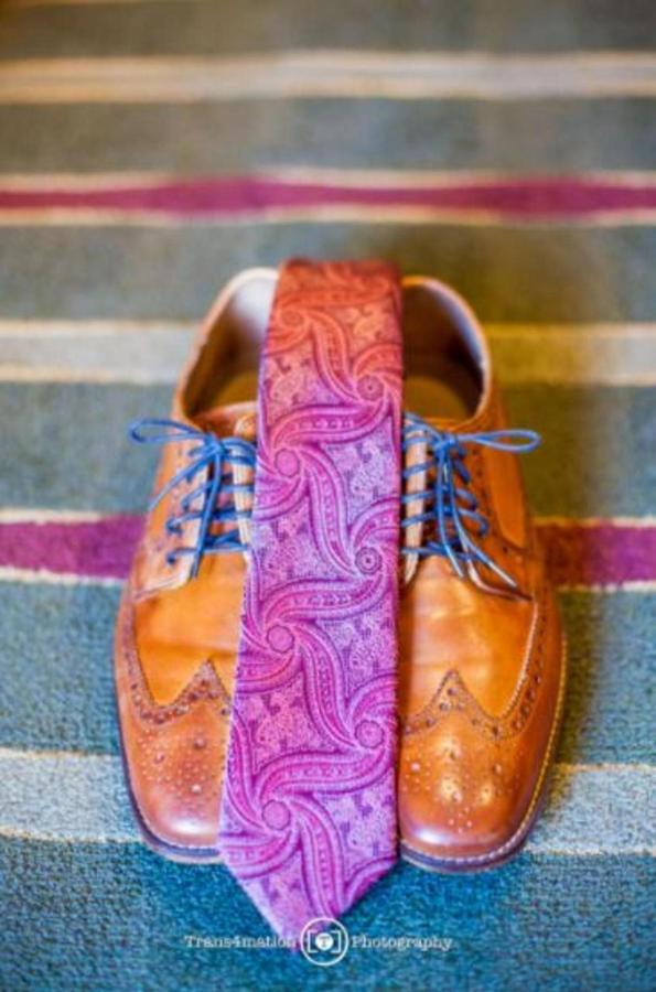 Pier 5 Hotel Groom Shoe Wedding Shot by Trans4mation Photography.jpg
